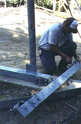 Custom built L brackets hold the 3 1/2 inch support pole